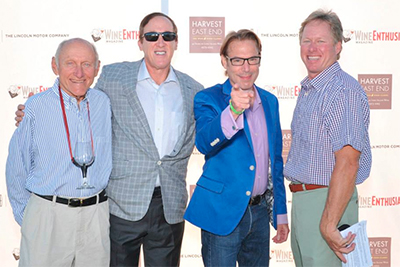 From left: Ron Goerler, Sr. of Jamesport Vineyards, Adam Strum of Wine Enthusiast, emcee Josh Wesson, Harvest East End event chair Ron Goerler, Jr.