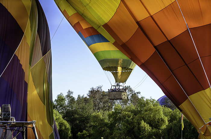 A balloon pilot gently brings his balloon in for a landing at the Temecula Balloon and Wine Festival, in Temecula California.