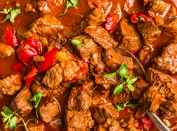 Beef that has been braised in a tomato paprika sauce