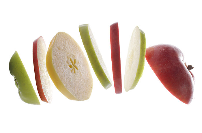 Cross sections of various varieties of apples, sliced
