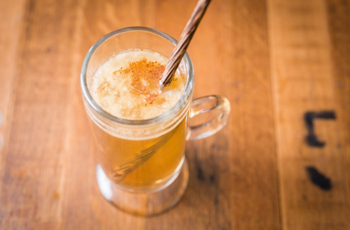 Hot buttered rum with spices and stirrer