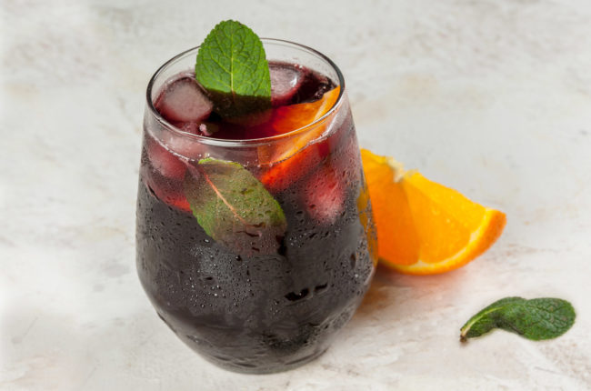 Glass of sangria with orange and mint