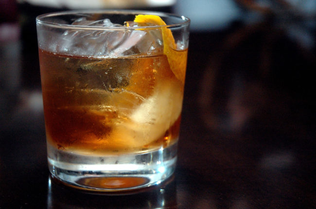 Rum Old Fashioned on the rocks with an orange twist