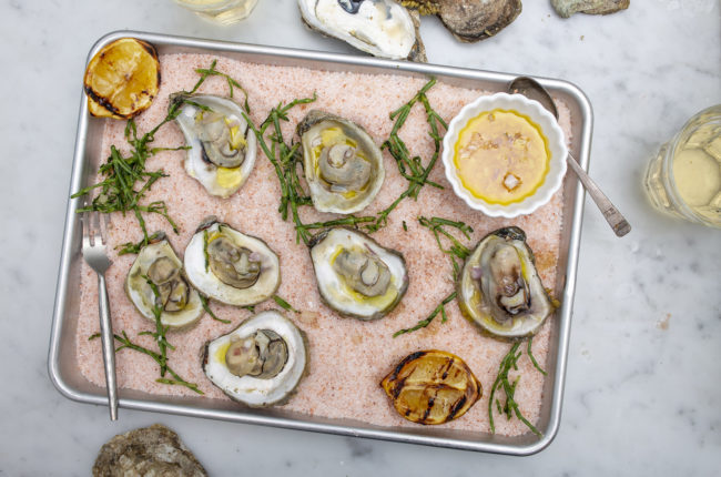 Steamed oysters on a bed of pink salt