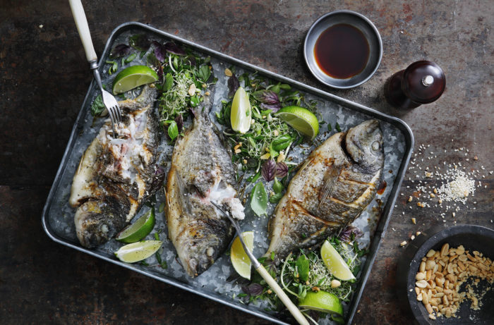 Crispy sea breams with herbs and lime
