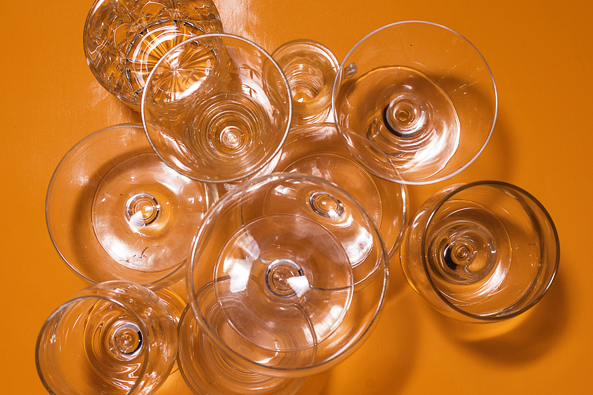 Wine glasses on an orange background
