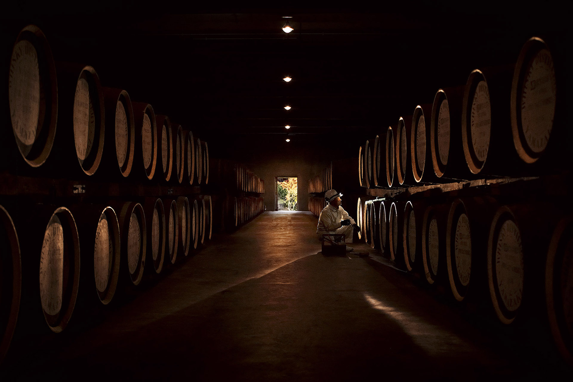 Dark shot of barrels with a door in the background