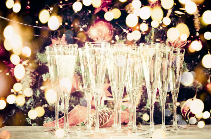 Glasses of sparkling wine against a blurry lights background