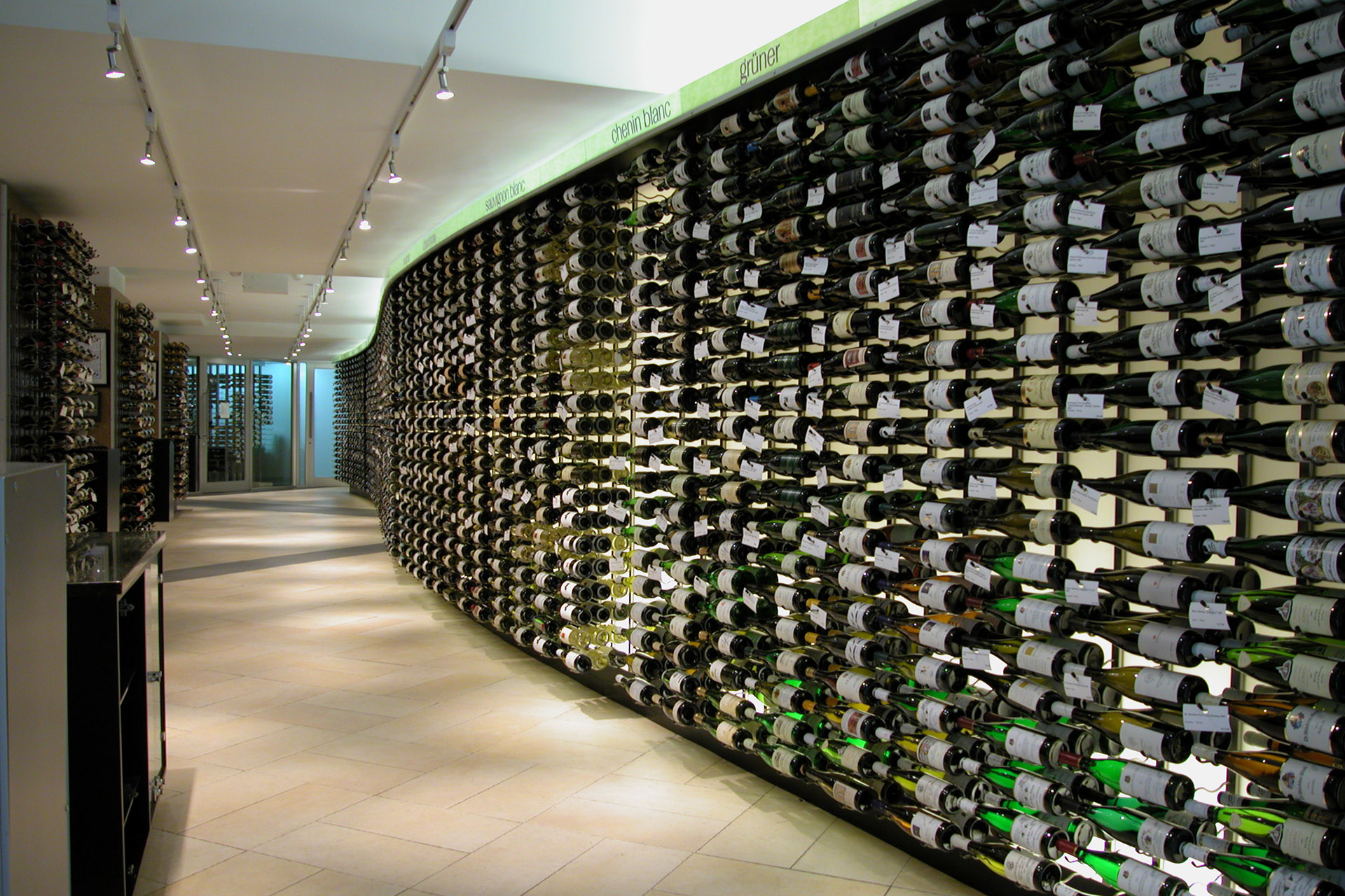 The curved wine wall at Crush Wine & Spirits, New York City, which forms an ingenious way to create space for 600 additional bottles