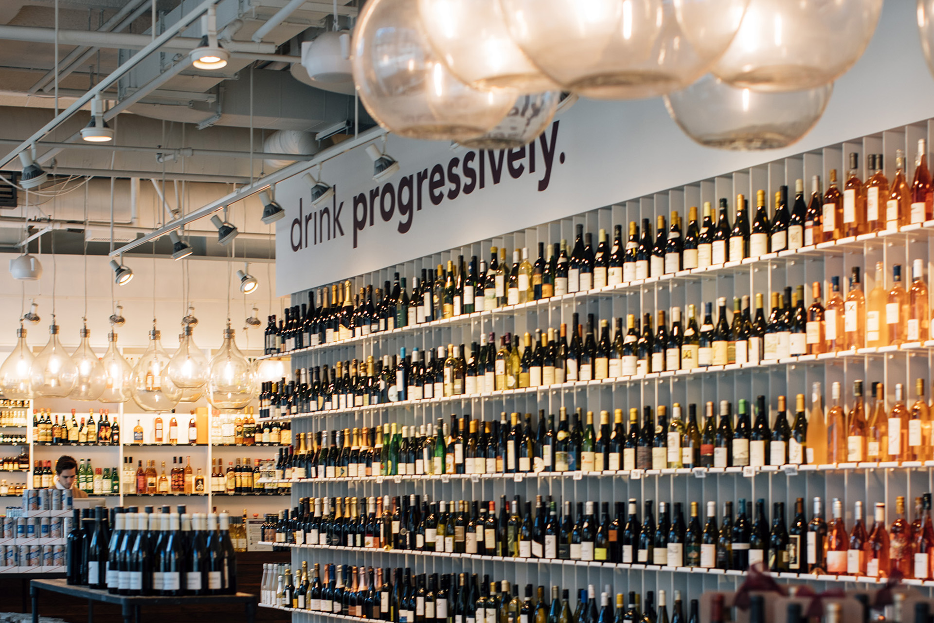 The floating wine wall of Urban Grape, Boston, designed to inform shoppers as to the body of a wine