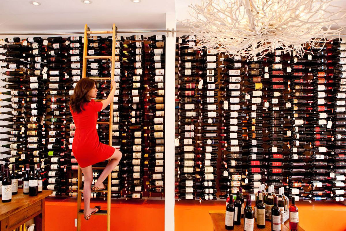 The library ladder that takes the wines of Biondivino, San Francisco, to new heights / Photo courtesy Biondivino Wine Boutique