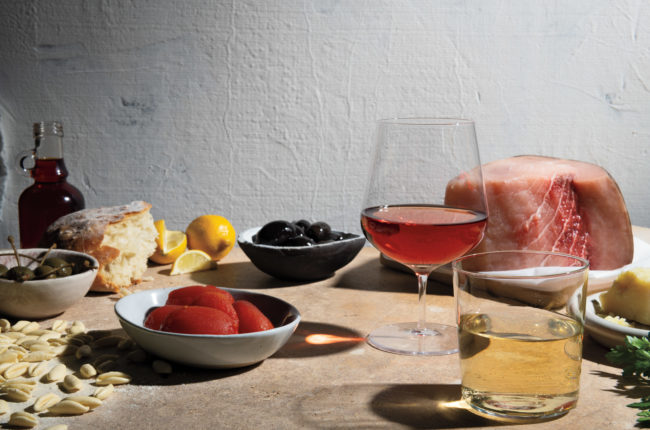 A photograph of dishes and wine from Southern Italy