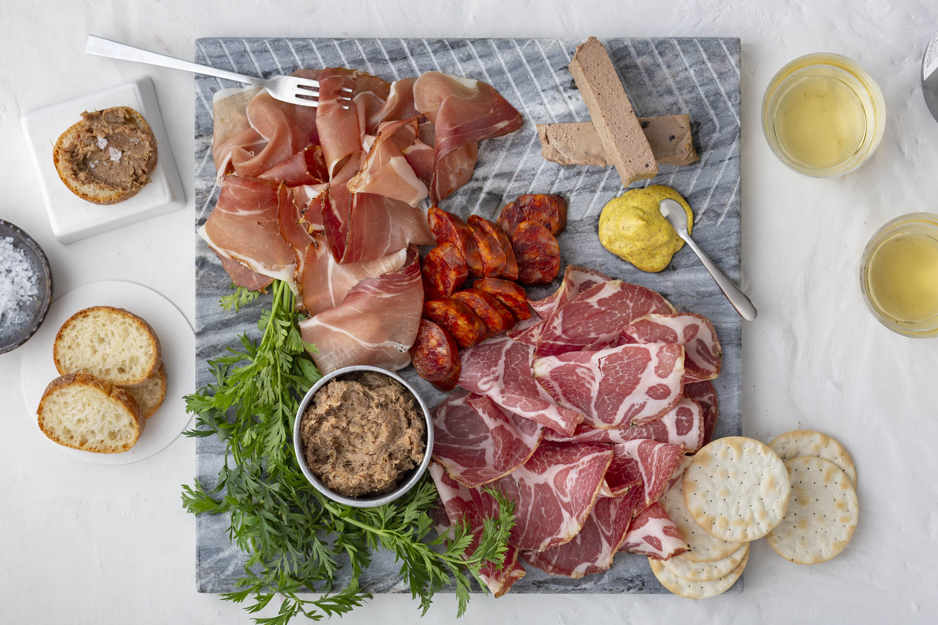 Speck, chorizo picante, coppa, duck rillette and mousse du périgord / Photo by Meg Baggott, styling by Jenn de la Vega