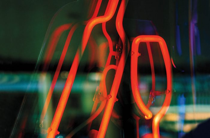 Neon sign in the form of a bottle and a glass / Stocksy