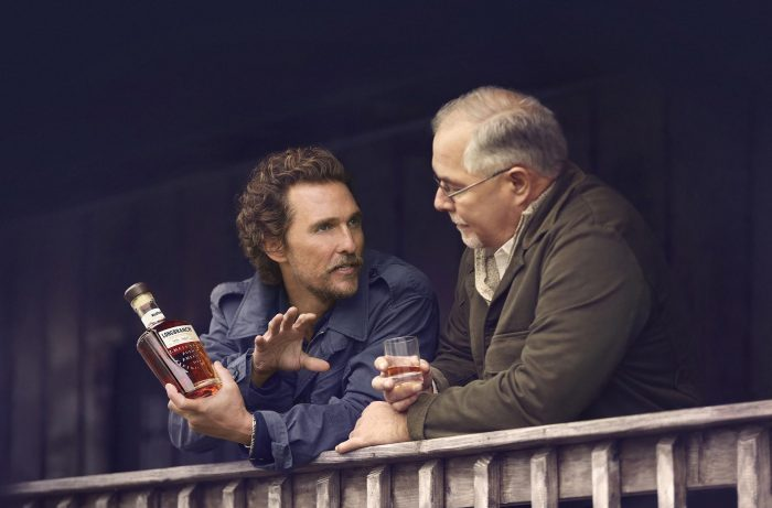 Matthew McConaughey and distiller with Bourbon.