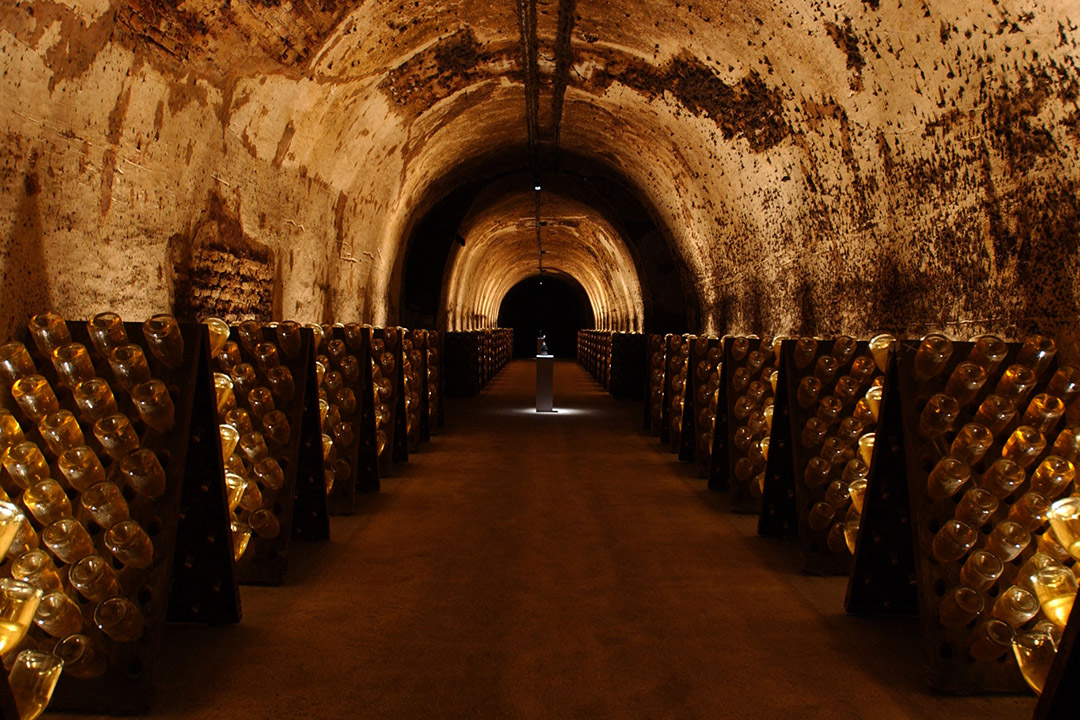 Ruinart's cellar with riddling racks lining the walls