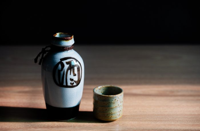 Sake bottle and cup on wood table