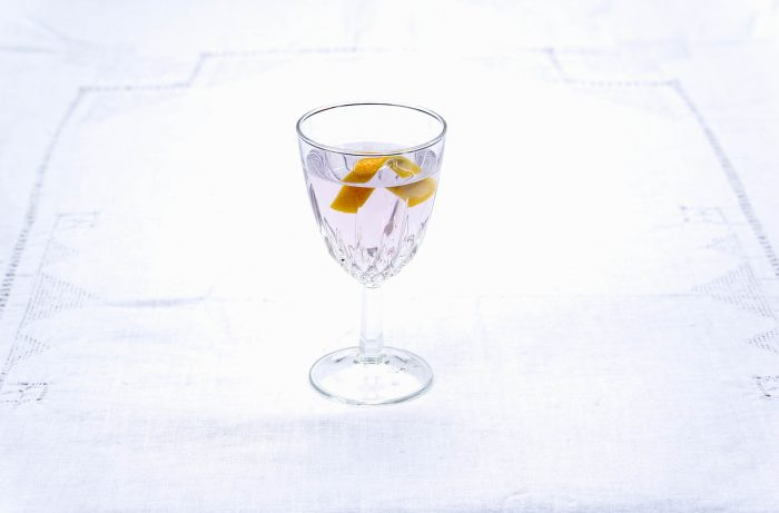 An El Presidente Cuban cocktail on white background
