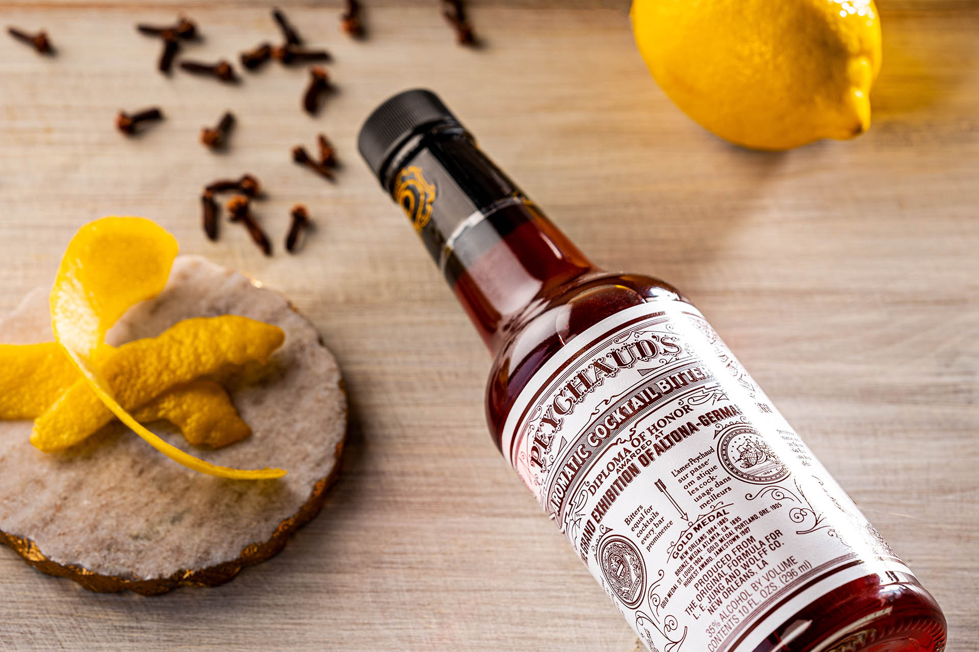Peychaud's Bitters with lemon peel and cloves