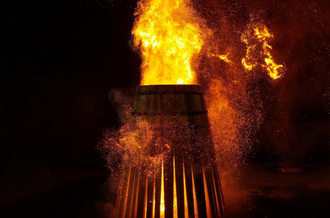 Oak barrel being charred with fire at Tevasa Cooperage in Jerez, Spain