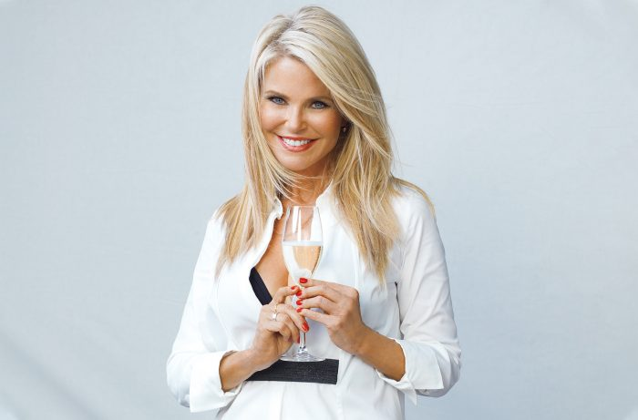 Christie Brinkley holding a glass of Prosecco/ Photo by Gian Andrea di Stefano