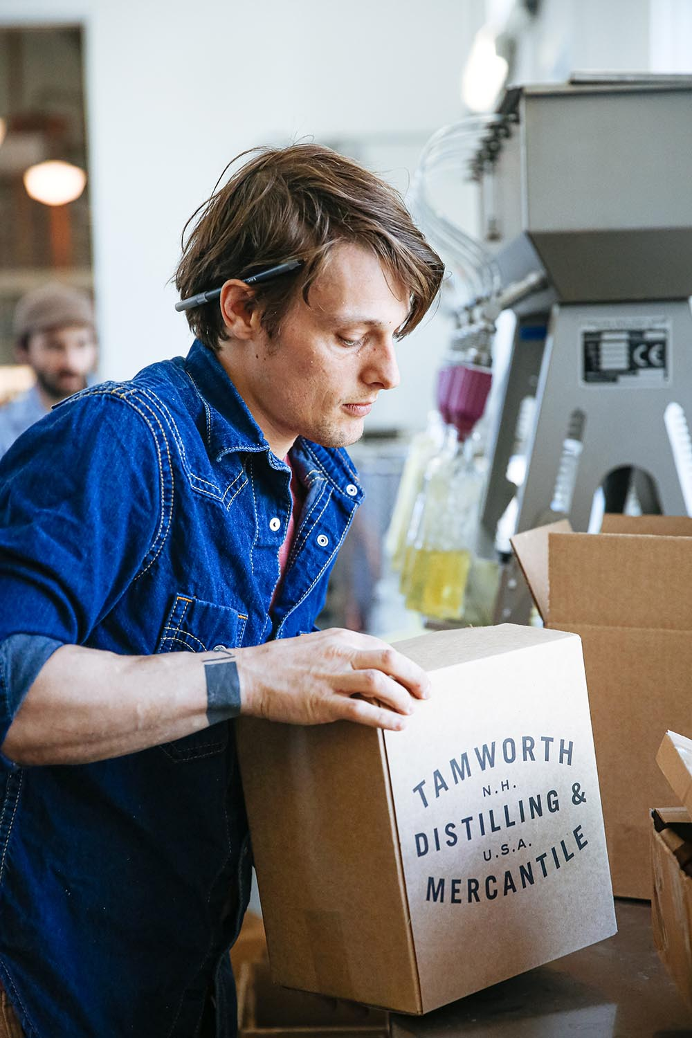 Jamie Oakes of Tamworth Distilling, packing cases of spirits on the bottling line