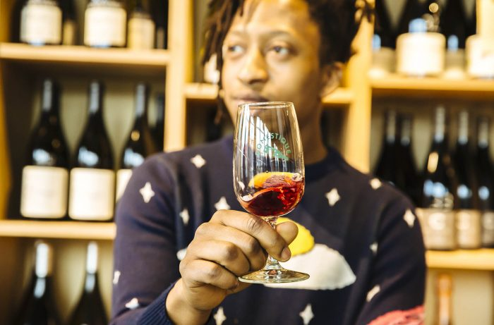 Eric Moorer of Domestique, holding a glass of wine