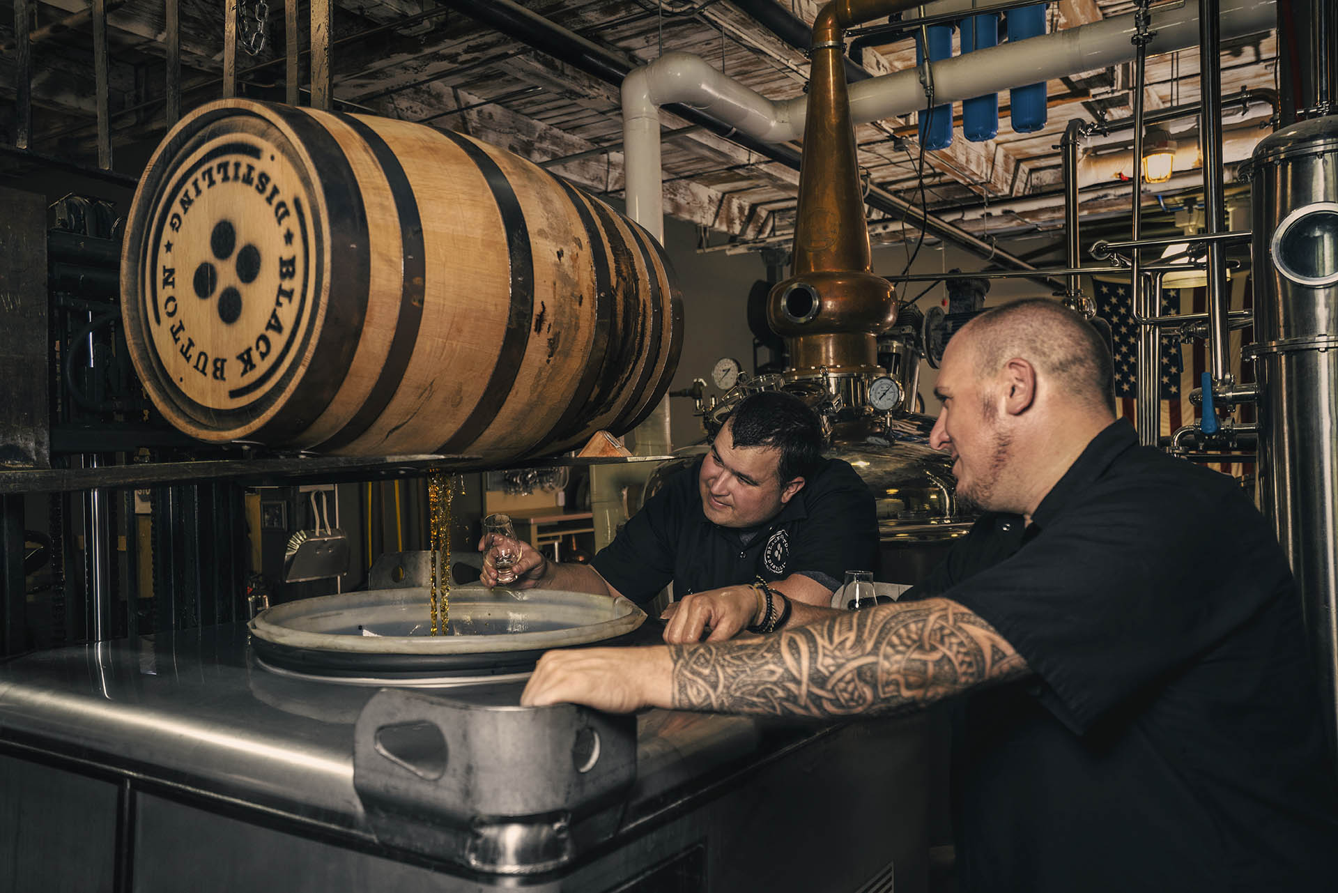 Founder of Black Button Distilling Jason Barrett (L) and Master Distiller Jeff Fairbrother (R)
