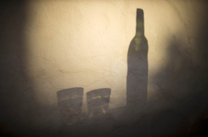 Shadow of wine bottle and glasses