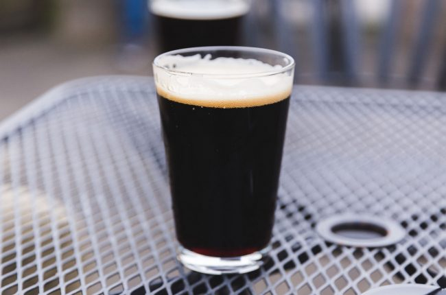 A pint glass with porter