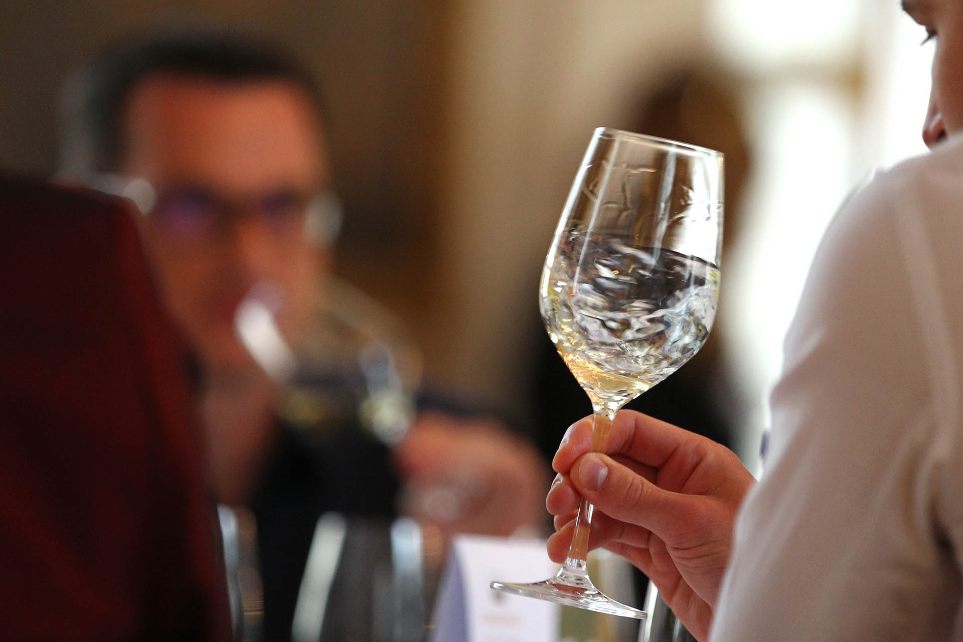 A juror swirls a glass of wine during the competition 'Best of Gold' in Wuerzburg, Germany, 11 May 2015. A jury elects the best wines from Franconia in the competition. Photo: Karl-Josef Hildenbrand /dpa | usage worldwide (Photo by Karl-Josef Hildenbrand/picture alliance via Getty Images)