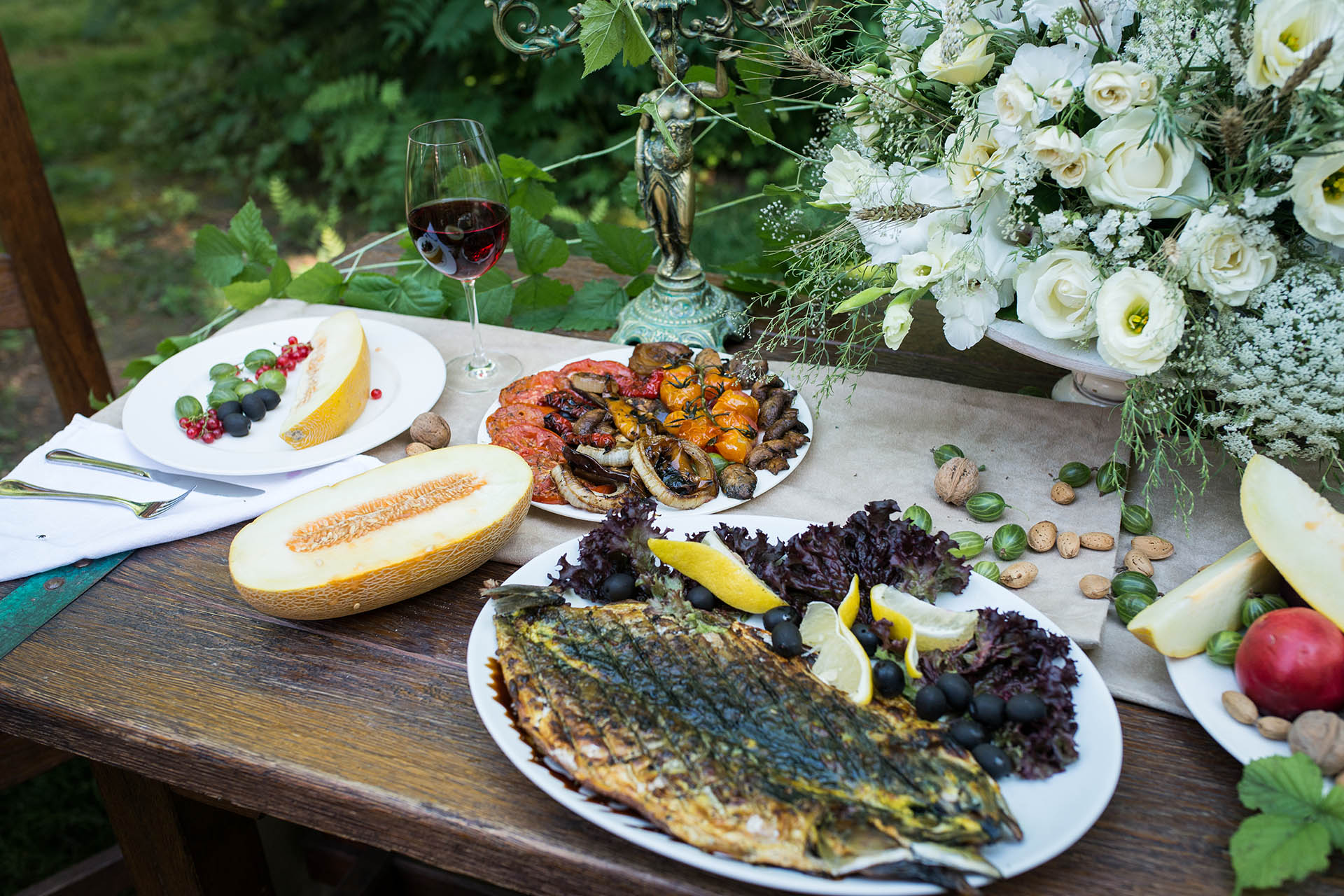 Armenian spread of grilled vegetables and fish with melon, red currants, currant and wine / Getty