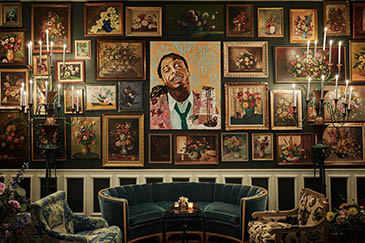Jack Rose interior, velvet couch next to wall of paintings