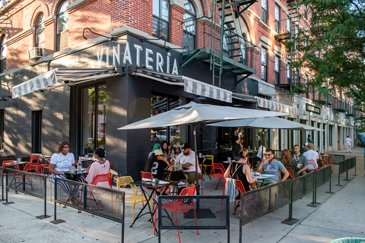Vinateria exterior with patron at outdoor tables