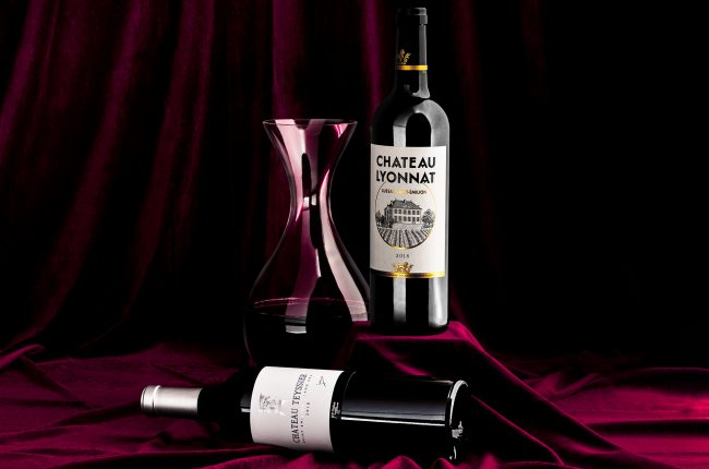 Bottles of red wine and red wine decanter